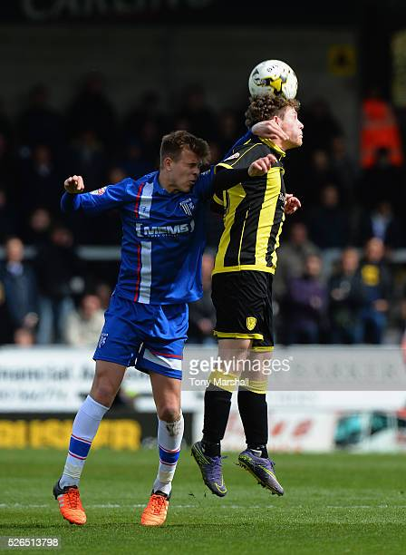 Matty Palmer of Burton Albion is tackled by Jake Hessenthaler of Gillingham during the Sky Bet League One match between Burton Albion and Gillingham...