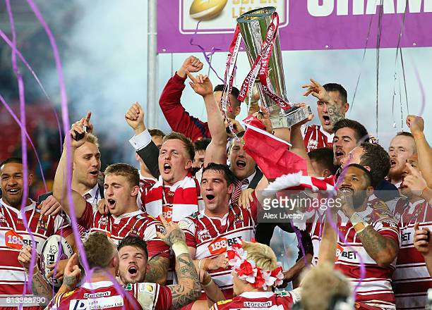 Matty Smith and Sean O'Loughlin of Wigan Warriors lift the First Utility Super League trophy aloft after victory over Warrington Wolves in the First...