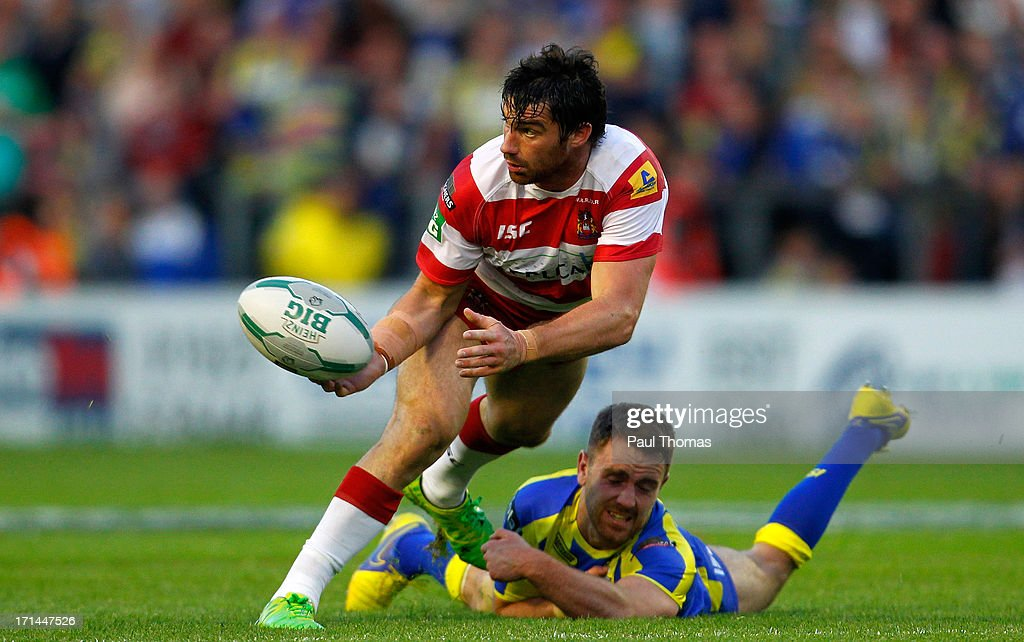 Matty Smith of Wigan (L) in action with Warrington's Richard Myler during the Super League match between Warrington Wolves and Wigan Warriors at the Halliwell Jones Stadium on June 24, 2013 in Warrington, England.