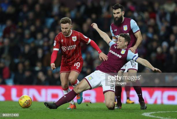 Matty Taylor of Bristol City is challenged byJames Chester during the Sky Bet Championship match between Aston Villa and Bristol City at Villa Park...
