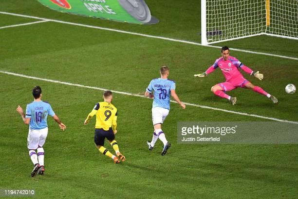 Matty Taylor of Oxford United scores his team's first goal during the Carabao Cup Quarter Final match between Oxford United and Manchester City at...