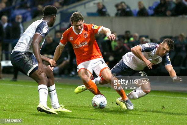 Matty Virtue of Blackpool FC is challenged by Dennis Politic of Bolton Wanderers during the Sky Bet Leauge One match between Bolton Wanderers and...