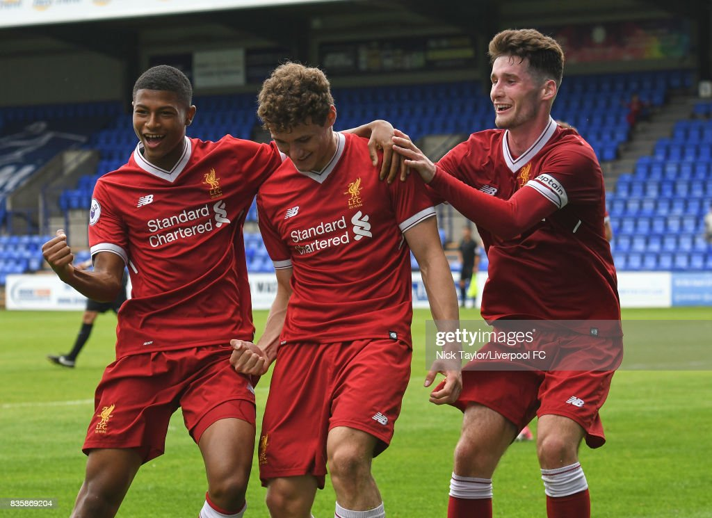 Matty Virtue (centre) of Liverpool celebrates his first goal with team mates Rhian Brewster (left) and Corey Whelan during the Liverpool v Sunderland U23 Premier League game at Prenton Park on August 20, 2017 in Birkenhead, England.