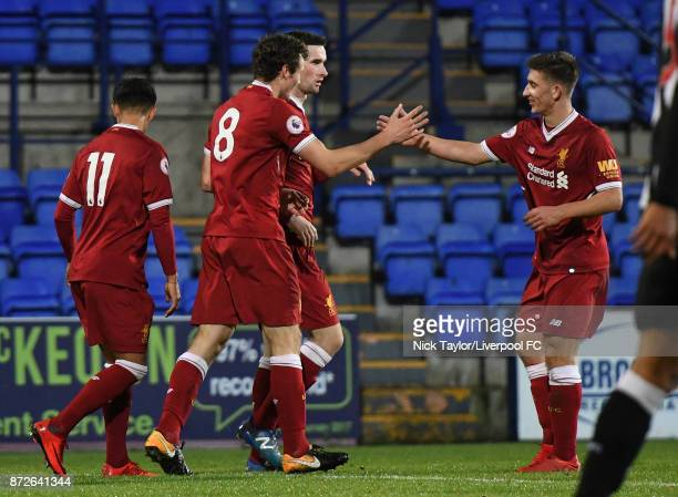 Matty Virtue of Liverpool celebrates his goal with team mate Cameron Brannagan during the Premier League International Cup match between Liverpool...