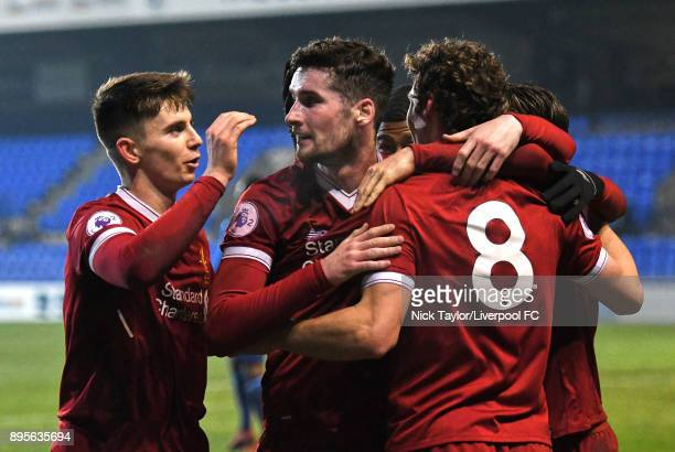 Matty Virtue of Liverpool celebrates his goal with team mates Ben Woodburn and Corey Whelan during the Liverpool v PSV Eindhoven Premier League...