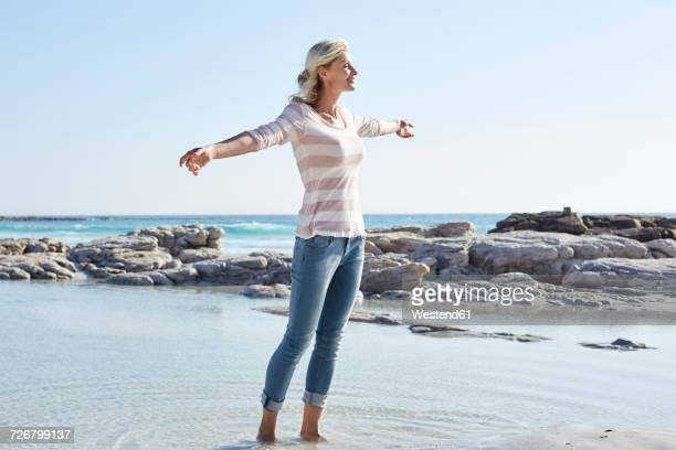 Matuer woman standing at the sea