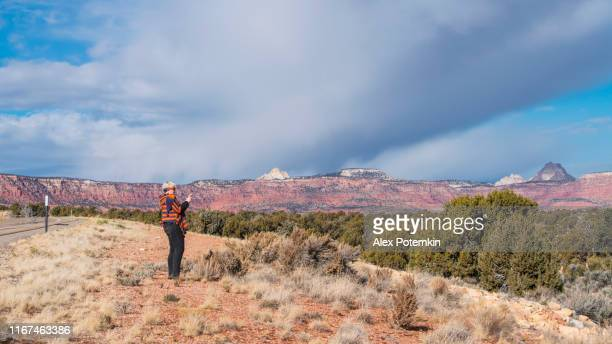 mature, 45-years-old, woman enjoying the nature in utah highland valley which grew with junipers. - 45 49 anni foto e immagini stock