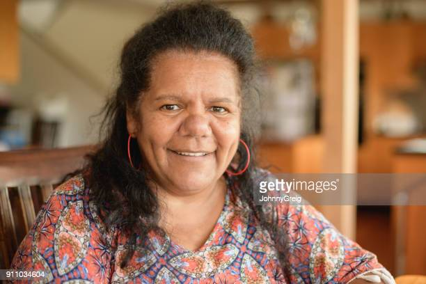 Mature Aboriginal woman looking at camera and smiling