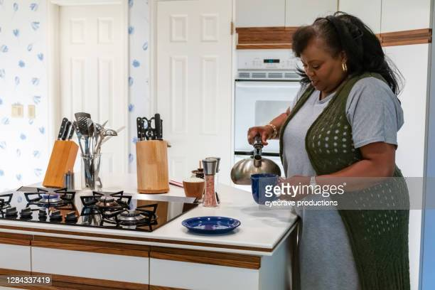 mature adult african american female enjoying moments indoors at home photo series - eyecrave  stock pictures, royalty-free photos & images