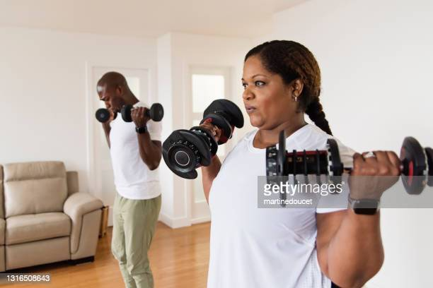 "mature adult couple doing exercise at home. - ""martine doucet"" or martinedoucet stock pictures, royalty-free photos & images"