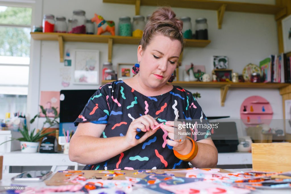 Mature adult female small business owner and designer working in studio office : Stock-Foto