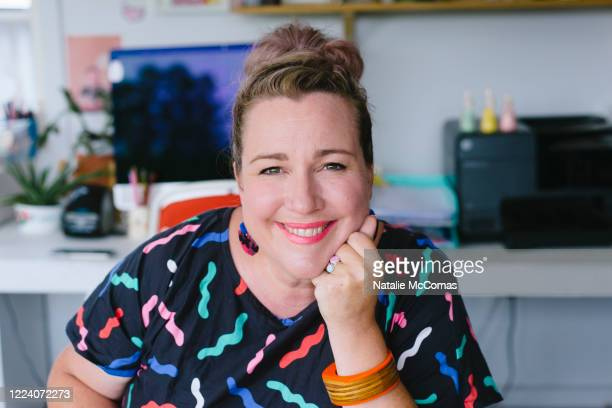 mature adult female small business owner and designer working in studio office - body concern stock pictures, royalty-free photos & images