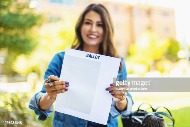 mature adult hispanic female voter with mail-in voting election ballot in western usa photo series - eyecrave  stock pictures, royalty-free photos & images