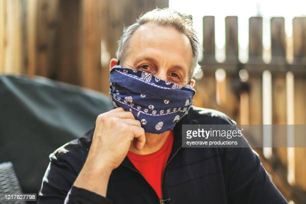mature adult male wearing face mask and social distancing due to infectious virus outbreak pandemic - home made stock pictures, royalty-free photos & images