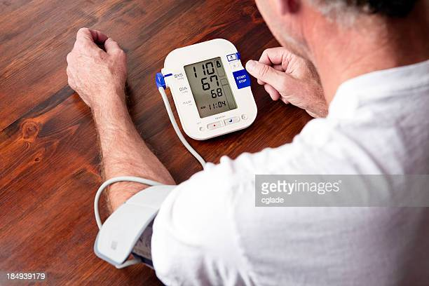 Mature adult man checking blood pressure