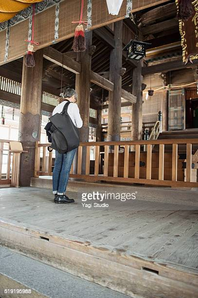 mature adult man japanese men worshiping in the shrine - shrine stock pictures, royalty-free photos & images