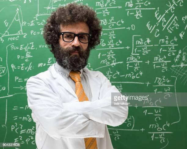 Mature Adult Man Portrait In Front Of Blackboard