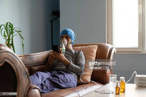 mature adult man using nebulizer at home - medical oxygen equipment stock pictures, royalty-free photos & images