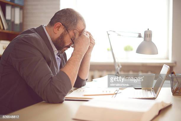 mature adult man working in the office - problems stock pictures, royalty-free photos & images