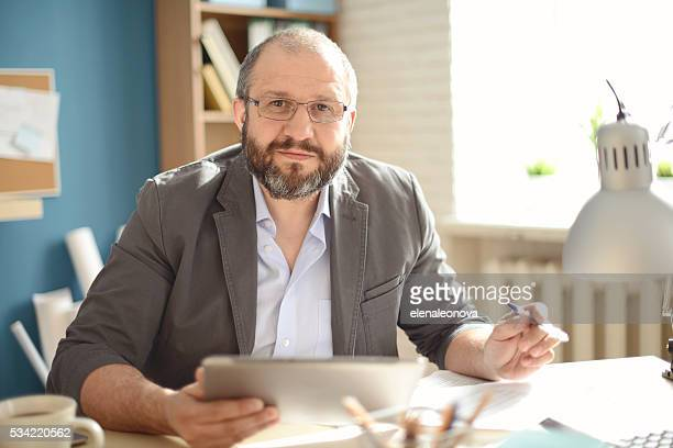 mature adult man working in the office - 45 49 years stock pictures, royalty-free photos & images