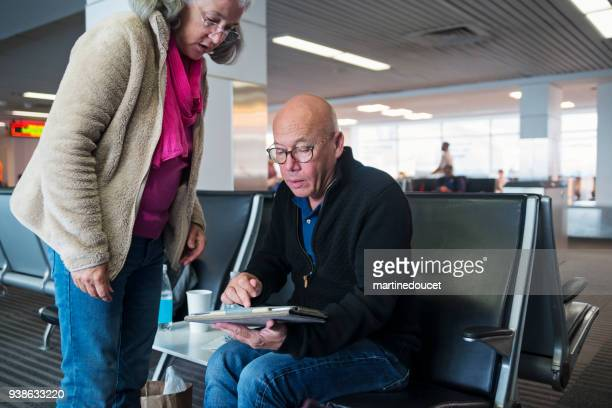 "mature adult on a casual business trip waiting in airport. - ""martine doucet"" or martinedoucet stock pictures, royalty-free photos & images"