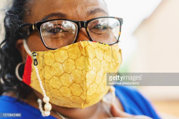 mature adult woman wearing face mask - eyecrave  stock pictures, royalty-free photos & images