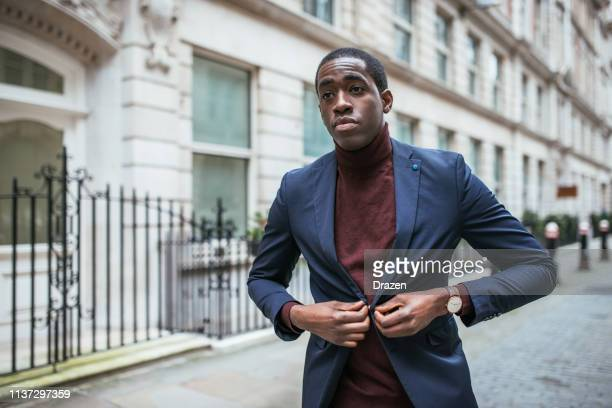 Mature African American businessman going to work in smart casual outfit.