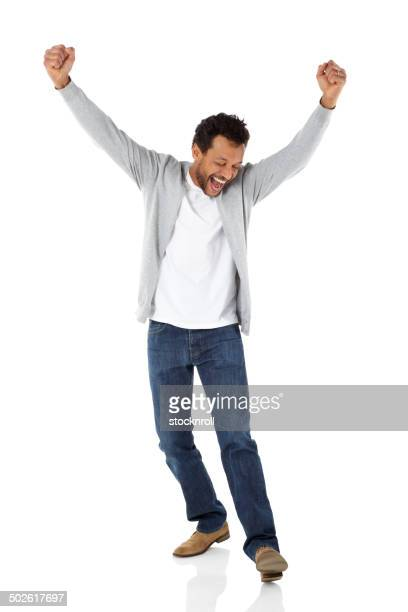 mature african man celebrating success - arms raised stock pictures, royalty-free photos & images