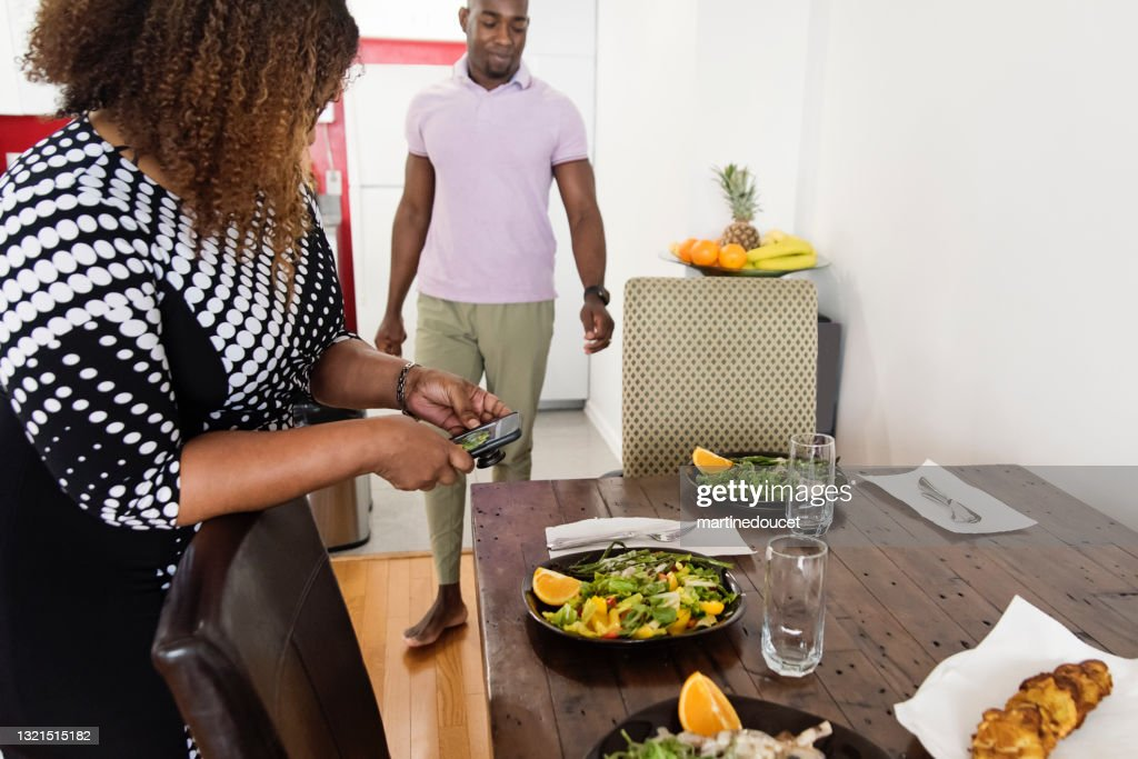 Mature African-American body positive woman photographing dish. : Stock Photo