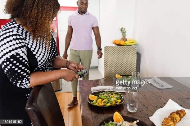"""mature african-american body positive woman photographing dish. - """"martine doucet"""" or martinedoucet stock pictures, royalty-free photos & images"""