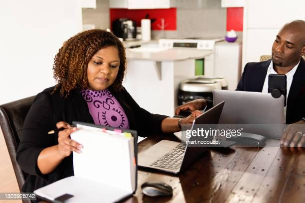 """mature african-american couple working from home. - """"martine doucet"""" or martinedoucet stock pictures, royalty-free photos & images"""