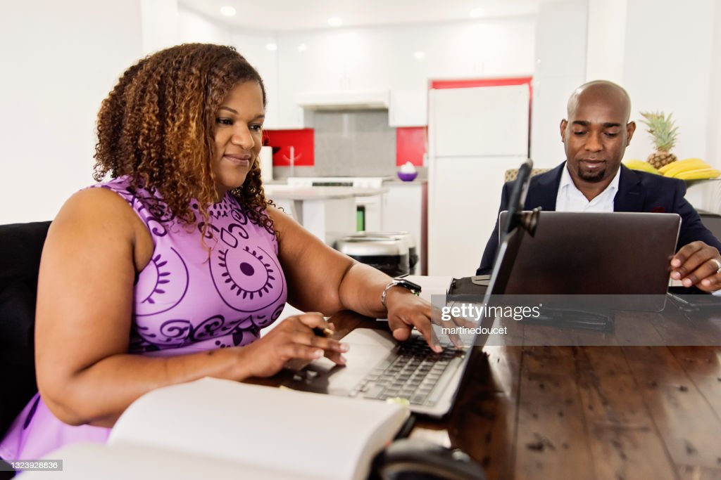 Mature African-American couple working from home. : Stock Photo