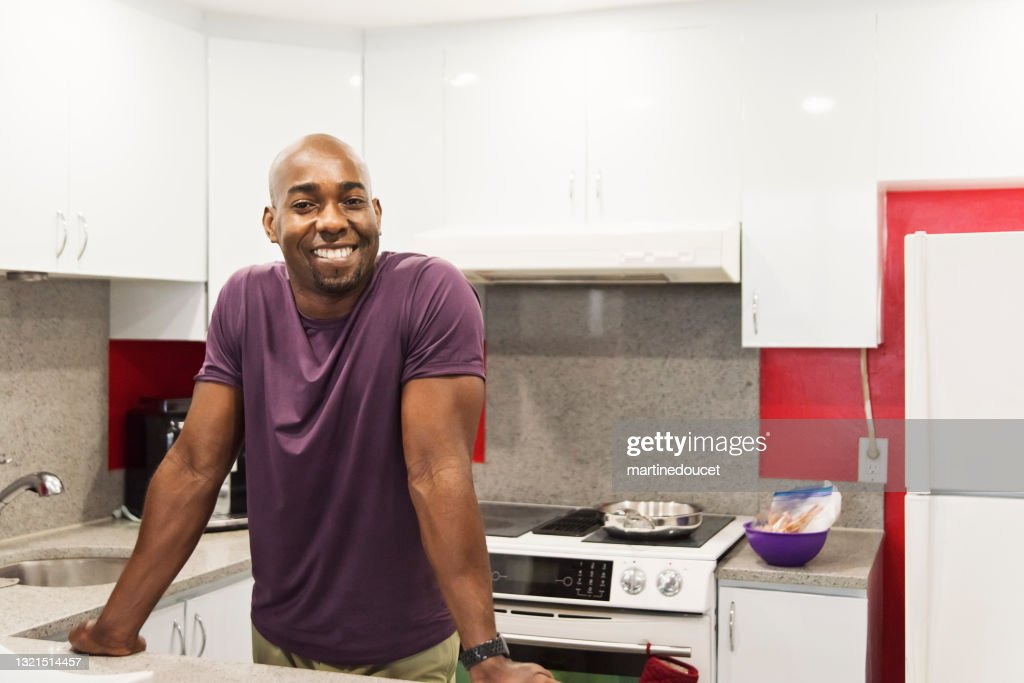 Mature African-American man in his kitchen. : Stock Photo