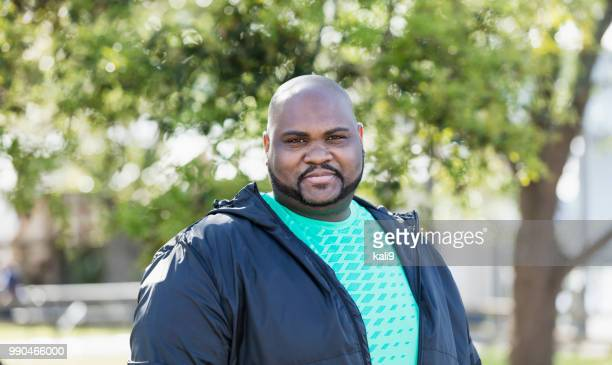 mature african-american man - fat black man stock photos and pictures