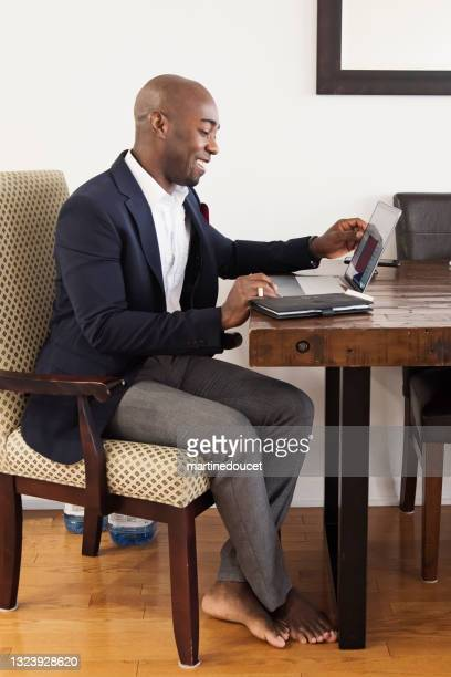 """mature african-american man working from home. - """"martine doucet"""" or martinedoucet stock pictures, royalty-free photos & images"""