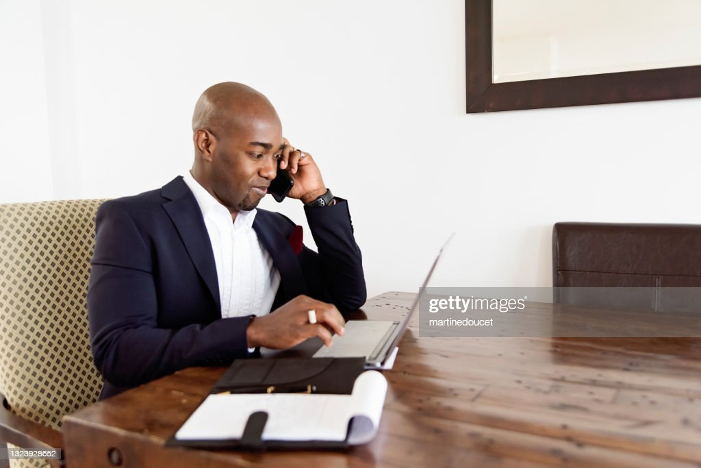 Mature African-American man working from home. : Stock Photo