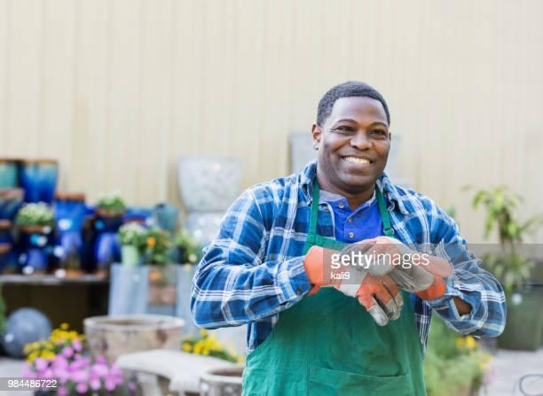 Mature African-American man working in plant nursery