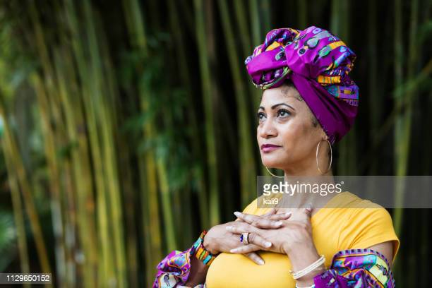 Mature African-American woman in colorful native costume