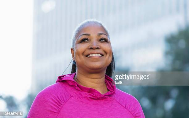 mature african-american woman outdoors in city - curvy women stock pictures, royalty-free photos & images