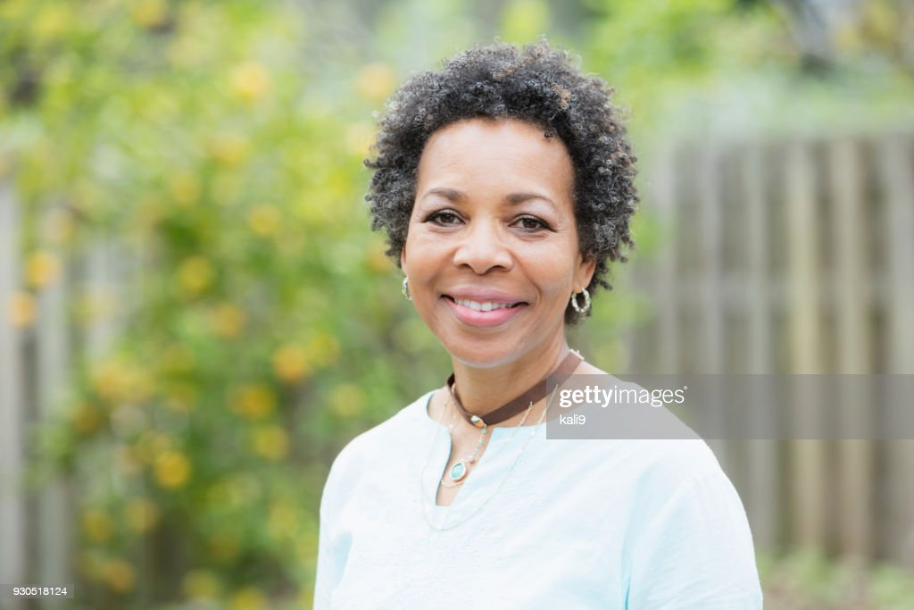 Mature African-American woman outdoors : Stock Photo