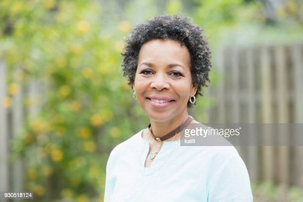 mature african-american woman outdoors - black women stock photos and pictures