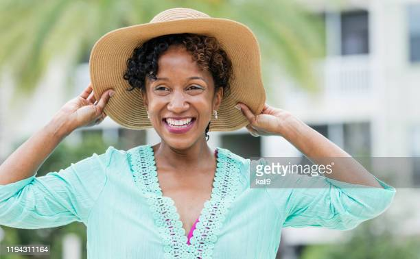 mature african-american woman wearing sun hat - sun hat stock pictures, royalty-free photos & images