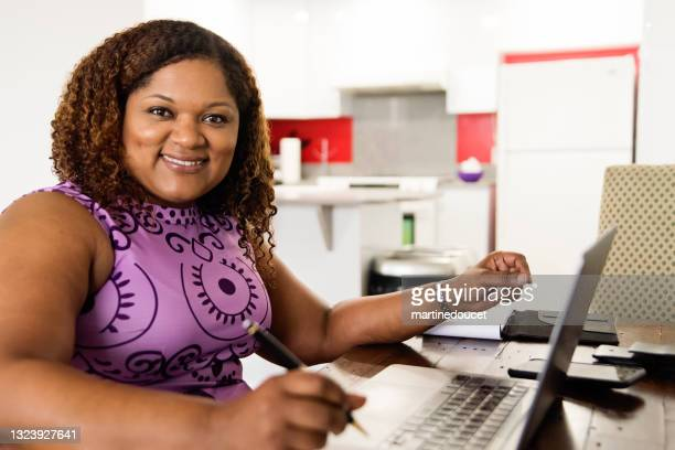 """mature african-american woman working from home in teleconference. - """"martine doucet"""" or martinedoucet stock pictures, royalty-free photos & images"""