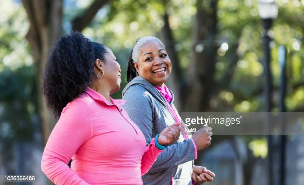 mature african-american women in city, exercising - older woman stock pictures, royalty-free photos & images