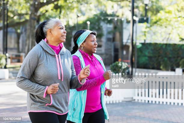 mature african-american women in city, exercising - only mature women stock pictures, royalty-free photos & images