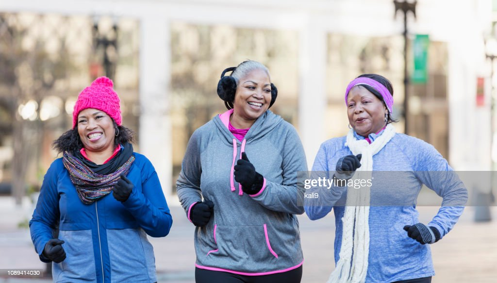Mature African-American women in city, exercising : Stock Photo