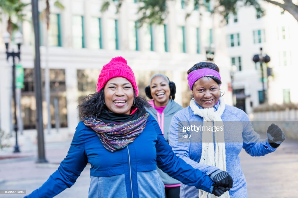 Mature African-American women in city, laughing : Stock Photo