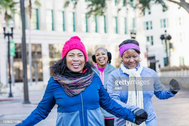Mature African-American women in city, laughing