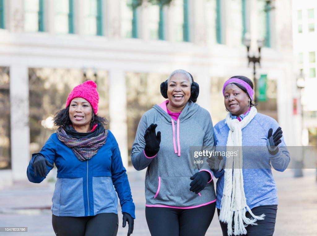 Mature African-American women in city, walking, talking : Stock Photo