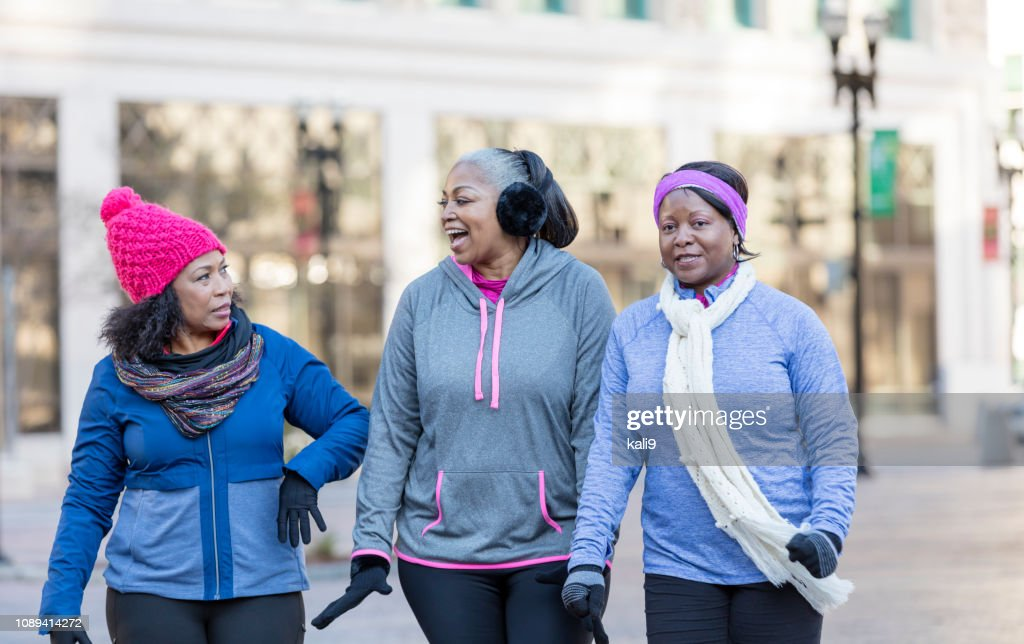 Mature African-American women in city, walking, talking : Stock Photo